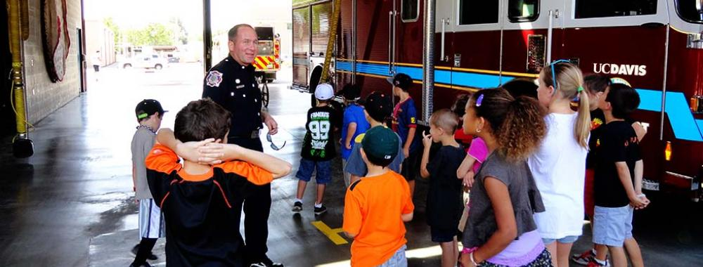 fireman talking to a group of children