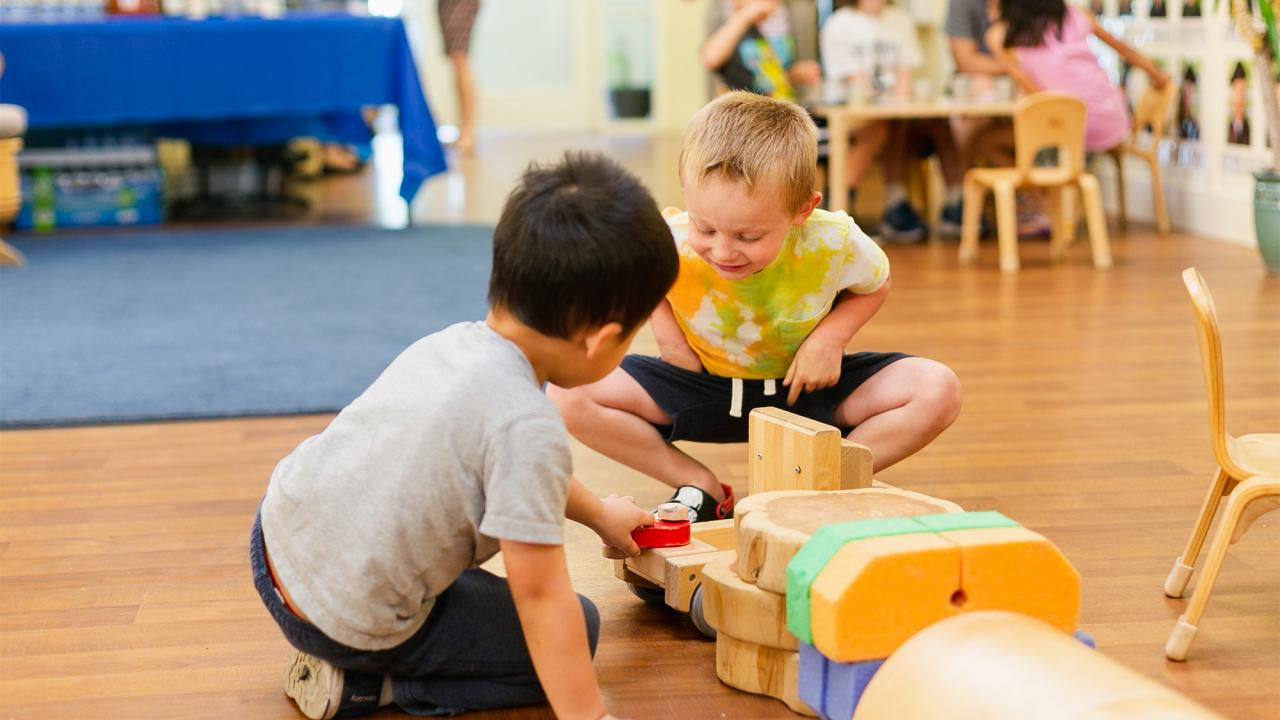 two young boys playing together at the uc davis hutchison child development center 10th anniversary celebrations