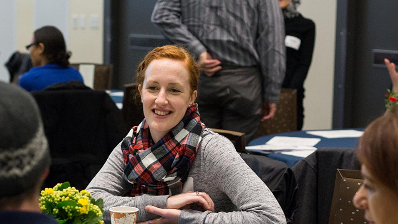 smiling woman at a welcome event